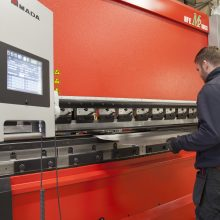 Operator using the Amada HFE 1003