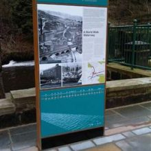 Canal-side information display and way finding monolith in Rochdale